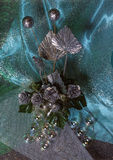Composition of artificial flowers and glass beads Stock Image