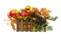 Composition from Artificial Fruits and Autumn Leaves in Wooden B Stock Images