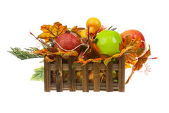 Composition from Artificial Fruits and Autumn Leaves in Wooden B Royalty Free Stock Photos