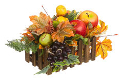 Composition from Artificial Fruits and Autumn Leaves in Wooden Box Royalty Free Stock Photo