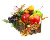 Composition from Artificial Fruits and Autumn Leaves in Wooden Box. Royalty Free Stock Images