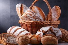 Composition with assorted bakery products. In wicker basket royalty free stock photography