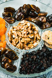 Composition with assorted dried fruits and nuts. Healthy dessert royalty free stock photos