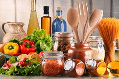 Composition with assorted food products and kitchen utensils Stock Photos