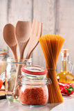 Composition with assorted food products and kitchen utensils Royalty Free Stock Photo