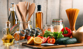 Composition with assorted food products and kitchen utensils Royalty Free Stock Image