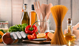 Composition with assorted food products and kitchen utensils. On the table royalty free stock photography