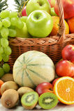Composition with assorted fruits in wicker basket Stock Photos