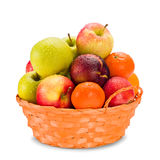 Composition with assorted fruits in wicker basket isolated on white Royalty Free Stock Photo
