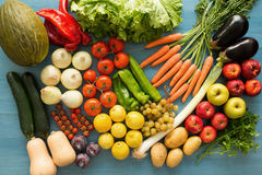 Composition with assorted raw organic vegetables. On a blue wooden background Stock Photo