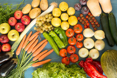 Composition with assorted raw organic vegetables. On a blue wooden background Royalty Free Stock Photos