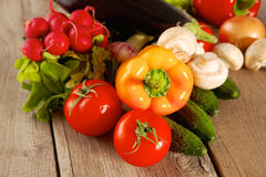 Composition with assorted raw organic vegetables wooden table Stock Photography