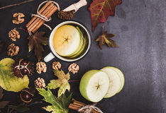 Composition of autumn leaves, chestnuts and ingredients for hot Stock Photo