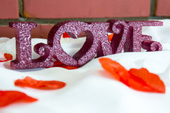 Composition avec des lettres de plastique d'amour Photographie stock