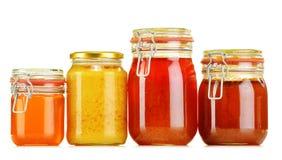 Composition avec le choc de miel sur le blanc Photographie stock libre de droits