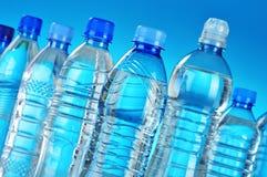 Composition avec les bouteilles en plastique assorties de l'eau minérale Photos stock