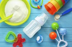 Composition with baby milk formula, rattles
