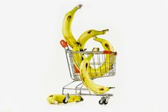 Composition from a banana. Yellow ripe bananas in the carriage from a supermarket Royalty Free Stock Images