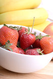 Composition of banana and strawberry close up Stock Images