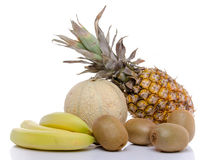 Composition with bananas, kiwis, a melon and a pineapple. Isolated on white royalty free stock photos