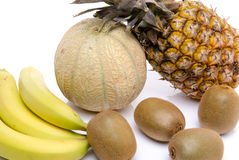 Composition with bananas, kiwis, a melon and a pineapple Royalty Free Stock Image