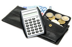 Composition with banknotes, coins, a wallet and a calculator. Isolated on white Stock Images