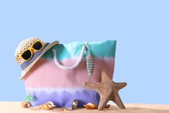Composition with beach accessories on sand against. Summer vacation concept. Composition with beach accessories on sand against color background. Summer vacation stock photos