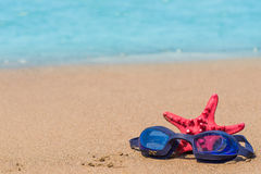 Composition on the beach with goggles for swimming Royalty Free Stock Photo