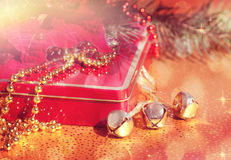 Composition of the Bells, Christmas Tree, Poinsettia and Gift Royalty Free Stock Photos