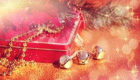 Composition of the Bells, Christmas Tree, Poinsettia and Gift Stock Image