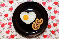 Composition of biscuits and egg in heart shape. Valentine`s Day Stock Photos