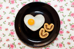 Composition of biscuits and egg in heart shape. Valentine`s Day Stock Images