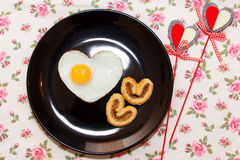 Composition of biscuits and egg in heart shape. Valentine`s Day Stock Photography