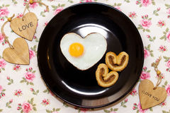 Composition of biscuits and eggs in heart shape and wooden heart Stock Photography