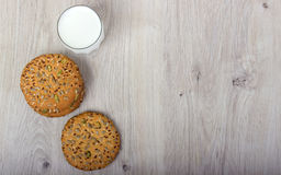 The composition of biscuits and a glass jar with yogurt. Stock Photography