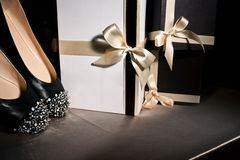 Composition black shoes with spikes. And gift boxes Stock Image