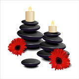 The composition of black stones, candles and red flowers Royalty Free Stock Image