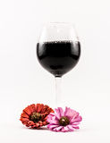 Composition of black wine and flowers on a white background Royalty Free Stock Photo