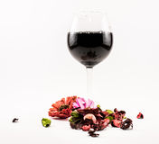 Composition of black wine and flowers on a white background Royalty Free Stock Photography