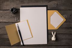 Composition of blank papers for invitations. On dark wooden table Stock Photo