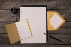 Composition of blank papers for invitations. On rustic wooden table Royalty Free Stock Image