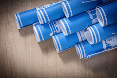 Composition of blue blueprint rolls on wooden board construction Stock Photography