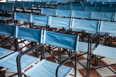 Composition of blue canvas folding chairs Royalty Free Stock Photography