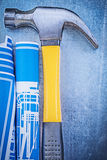Composition of blue engineering drawings claw hammer on metallic Royalty Free Stock Photography