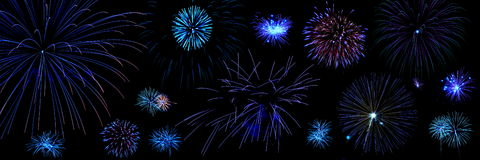 Composition of blue fireworks. Large composition of blue tone fireworks over black background royalty free stock photos