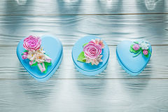 Composition of blue gift boxes on wooden board holidays concept Stock Photos