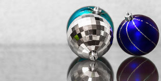 The composition of blue and silver Christmas balls. Stock Photo