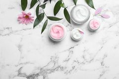 Composition with body cream in jars Royalty Free Stock Images