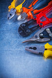 Composition of bolt cutter tin snips cutting Royalty Free Stock Photography