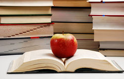 Composition with books and apple. Composition with hardcover books and apple on table Royalty Free Stock Photography